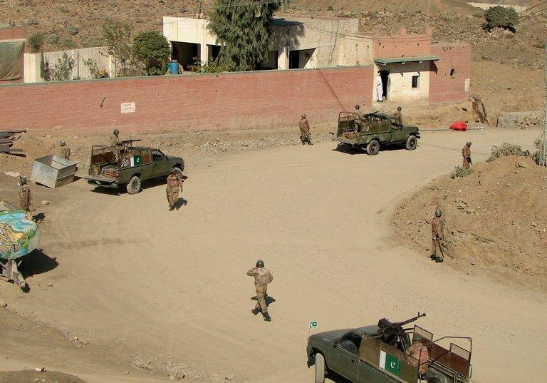 Pakistani army soldiers patrol outside a local tribal police checkpost in Miranshah, May 10, 2013