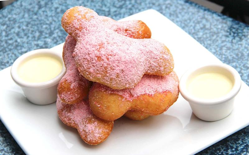 Mint Julep Bar's beloved beignets now come candy cane-dusted.