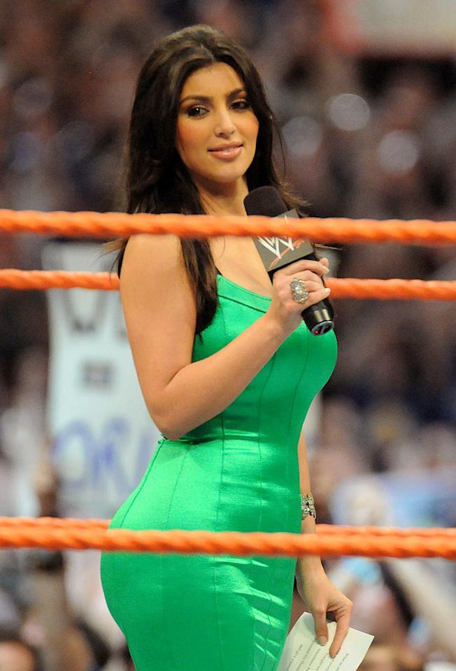 """Bootylicious reality TV star Kim Kardashian dons a form-fitting green dress for her hosting duties at Wrestlemania XXIV in Orlando, Florida. George Napolitano/<a href=""""http://www.filmmagic.com/"""" target=""""new"""">FilmMagic.com</a> - March 30, 2008"""