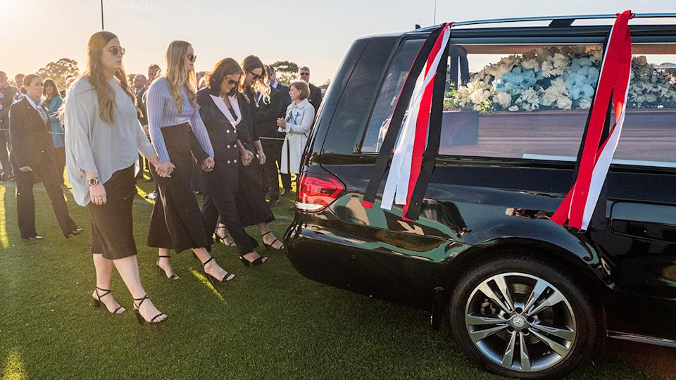 Danny Frawley's wife and daughters, pictured here during a lap of honour at his memorial service.