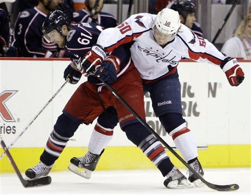 Washington Capitals' Cody Eakin (50) and Columbus Blue Jackets' Rick Nash (61) chase a loose puck during the second period of an NHL hockey game, Saturday, Dec. 31, 2011, in Columbus, Ohio. (AP Photo/Jay LaPrete)