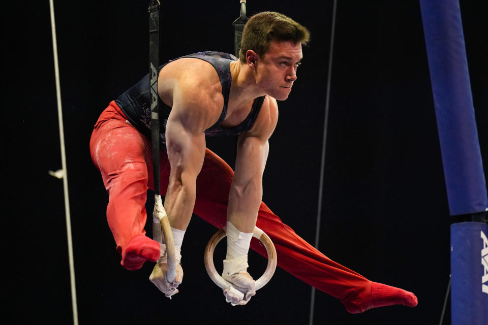 Brody Malone competes on the still rings during the men's U.S. Olympic Gymnastics Trials Thursday, June 24, 2021, in St. Louis. (AP Photo/Jeff Roberson)