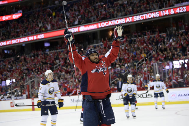Washington Capitals left wing Alex Ovechkin (8), of Russia, celebrates his goal during the second period of an NHL hockey game against the Buffalo Sabres, Saturday, Dec. 15, 2018, in Washington. (AP Photo/Nick Wass)