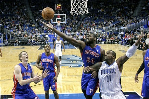 Detroit Pistons' Jason Maxiell (54) goes after a rebound in front of Orlando Magic's Glen Davis (11) as Detroit Pistons' Kyle Singler, left, and Brandon Knight (7) look on during the first half of an NBA basketball game, Wednesday, Nov. 21, 2012, in Orlando, Fla. (AP Photo/John Raoux)