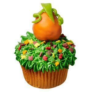 """<p>A magical harvest emerges with just a few tasty tricks: green-tinted vanilla frosting for grass, a glazed doughnut hole dipped in orange frosting for the pumpkin and strips of candy for the vines and leaves.</p><p><strong><a href=""""https://www.countryliving.com/food-drinks/recipes/a32679/great-pumpkin-cupcake-recipe-122726/"""" rel=""""nofollow noopener"""" target=""""_blank"""" data-ylk=""""slk:Get the recipe"""" class=""""link rapid-noclick-resp"""">Get the recipe</a>.</strong></p>"""