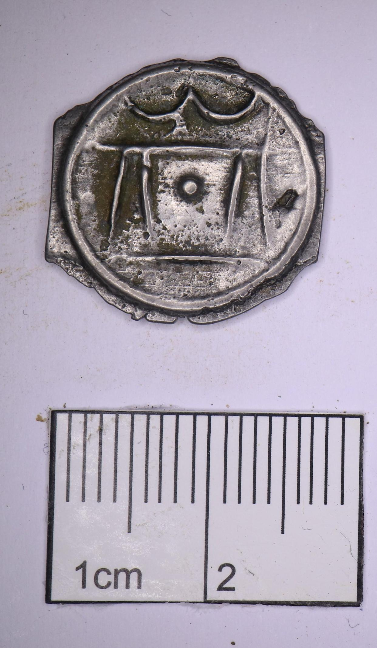 A rare historic coin found by archaeologists working on the HS2 route in Hillingdon, west London, after excavation (HS2/PA).