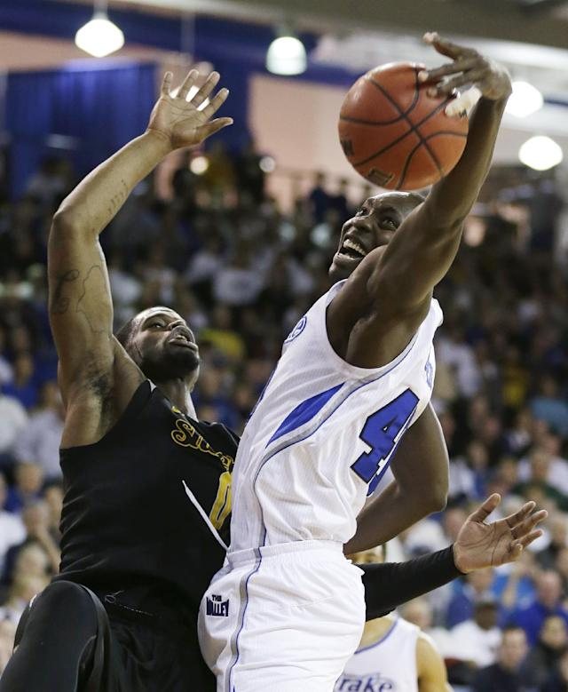 Drake forward Daddy Ugbede, right, grabs a rebound in front of Wichita State forward Chadrack Lufile during the first half of an NCAA college basketball game, Saturday, Jan. 25, 2014, in Des Moines, Iowa. (AP Photo/Charlie Neibergall)