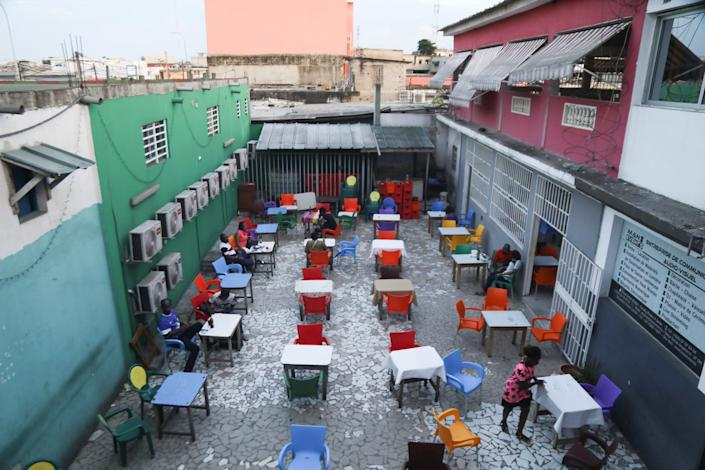 """The almost empty outside part of restaurant Riviera 2 is pictured in Abidjan, Ivory Coast, on May 20, 2020. <p class=""""copyright"""">REUTERS/Luc Gnago</p>"""