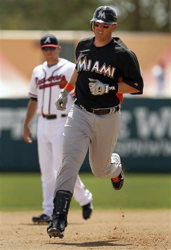 Miami Marlins' Terry Tiffee rounds second base after hitting a solo home run in the fourth inning of a spring training baseball game against the Atlanta Braves in Kissimmee, Fla., Thursday, March 22, 2012. (AP Photo/Paul Sancya)
