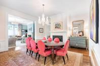 <p>The open floor plan is ideal for entertaining. We love how the spacious dining room flows seamlessly into the kitchen, den, and main hallway.</p>