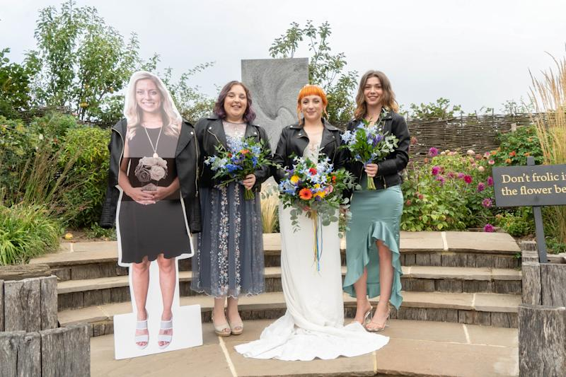 Woman on her wedding day with a cut-out cardboard bridesmaid