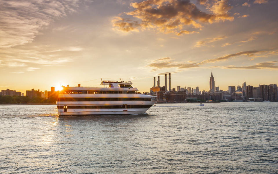 Cruise ship on East River in New York City at sunset, (Photo: Getty Images)
