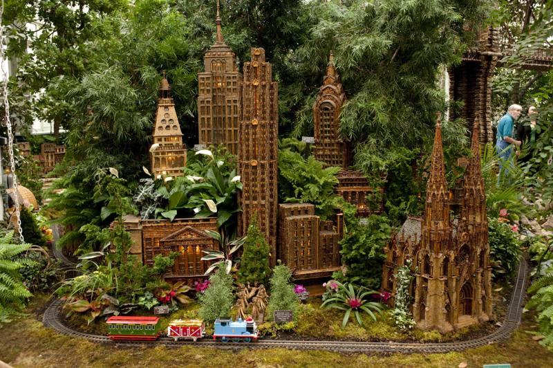 This November 2012 photo provided by the New York Botanical Garden shows the annual holiday train show at the garden in the Bronx borough of New York, where model trains on view in the Enid A. Haupt Conservancy wind past 140 buildings depicting New York City, including landmarks like the original Yankee Stadium, St. Patrick's Cathedral and the Brooklyn Bridge. Holiday train shows also take place at a number of other botanic gardens around the country including those in Chicago and Cincinnati. (AP Photo/New York Botanical Garden, Ivo M. Vermeulen)