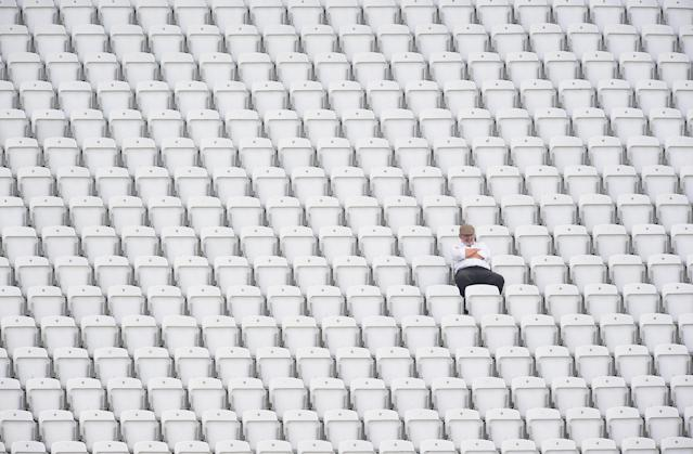 NOTTINGHAM, ENGLAND - APRIL 29: A lone spectator watches the action during day one of the LV County Championship division one match between Nottinghamshire and Sussex at Trent Bridge on September 15, 2014 in Nottingham, England. (Photo by Laurence Griffiths/Getty Images)