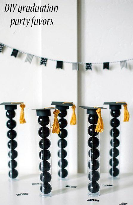 "<p>This easy DIY looks great on display, but also makes a very fun and portable takeaway for guests. </p><p><a href=""https://www.nobiggie.net/diy-graduation-party-favors/"" rel=""nofollow noopener"" target=""_blank"" data-ylk=""slk:Get the tutorial."" class=""link rapid-noclick-resp"">Get the tutorial.</a></p><p><a class=""link rapid-noclick-resp"" href=""https://www.amazon.com/Large-Black-Gumballs-Diameter-Buffet/dp/B01MR3I4RA/?tag=syn-yahoo-20&ascsubtag=%5Bartid%7C10063.g.36078412%5Bsrc%7Cyahoo-us"" rel=""nofollow noopener"" target=""_blank"" data-ylk=""slk:SHOP GUMBALLS"">SHOP GUMBALLS</a></p>"