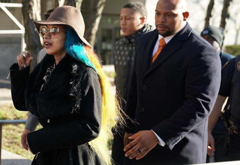 Rapper Cardi B (L) appeared in a Queens criminal court to face charges stemming from a strip club fight in Queens -- on the same day that she earned five Grammy nominations