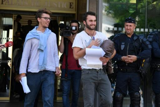 Swiss student Bastien Stauffer, 26, and Theo Buckmaster, a 23-year-old Swiss-Belgian, leave court in Gap in the French Alpes where they are on trial with an Italian student for helping migrants cross the border