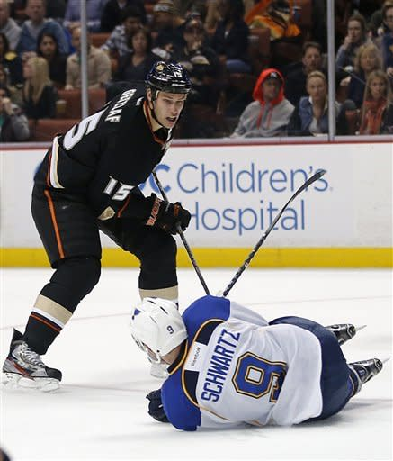 St. Louis Blues' Jaden Schwartz (9) falls to the ice as Anaheim Ducks' Ryan Getzlaf watches during the second period of an NHL hockey game in Anaheim, Calif., Sunday, March 10, 2013. (AP Photo/Jae C. Hong)
