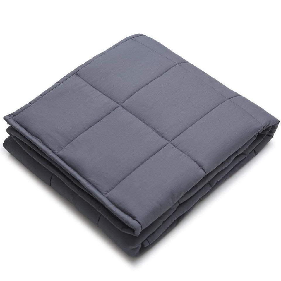 <p>This <span>YnM Weighted Blanket</span> ($65) will keep you warm and comforted. It's the perfect thing to grab for a movie marathon.</p>