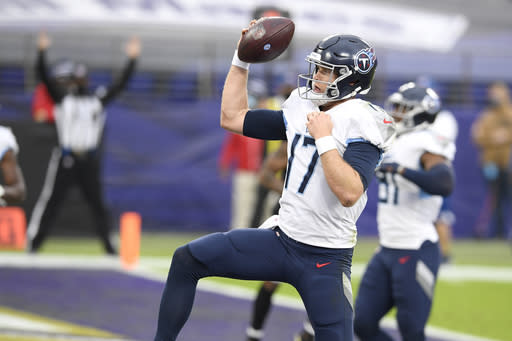 Tennessee Titans quarterback Ryan Tannehill reacts after running the ball in on a 2-point conversion against the Baltimore Ravens during the second half of an NFL football game, Sunday, Nov. 22, 2020, in Baltimore. (AP Photo/Nick Wass)