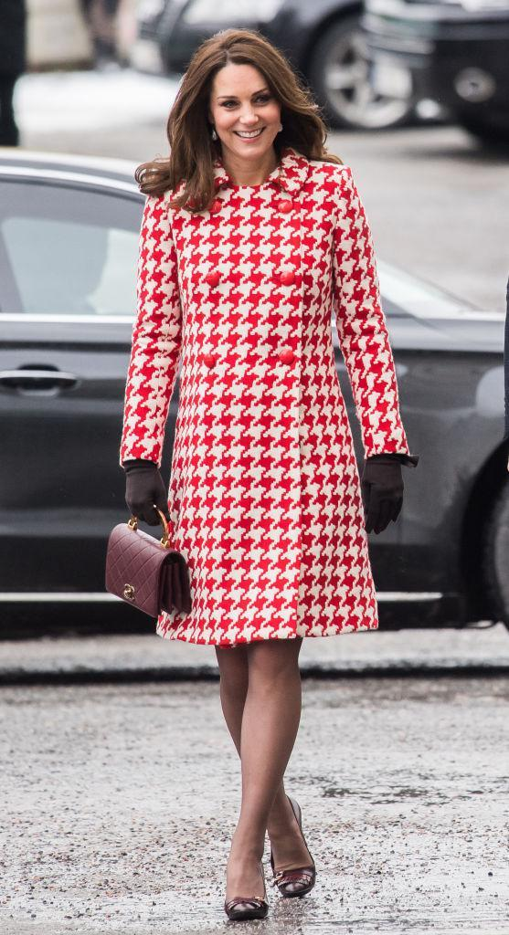 <p>The Duchess dressed her bump in one of her chicest looks to date to visit Matteusskolan School in Sweden on January 31, 2018. She teamed a houndstooth coat with a Chanel handbag and co-ordinating shoes. <em>[Photo: Getty]</em> </p>