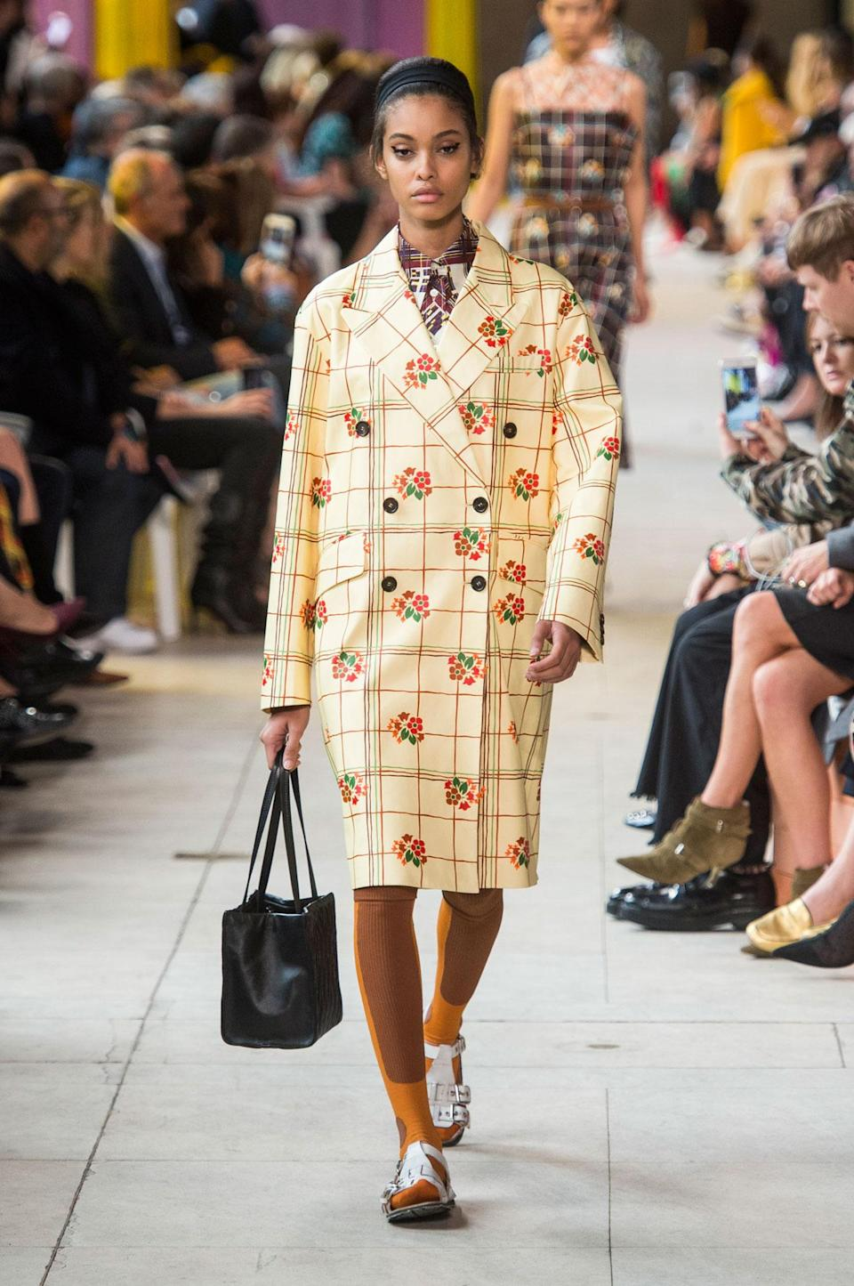<p>Floral printed pale yellow coat from the SS18 Miu Miu collection. (Photo: ImaxTree) </p>