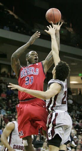 Mississippi's Murphy Holloway (31) shoots as South Carolina's Michael Carrera (24) defends during the first half of an NCAA college basketball game Wednesday, Feb. 20, 2013, in Columbia, S.C. ( AP Photo/Mary Ann Chastain)