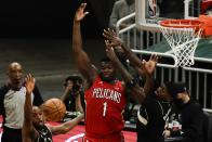 New Orleans Pelicans' Zion Williamson goes after a rebounds with Milwaukee Bucks' Bobby Portis and Khris Middleton during the second half of an NBA basketball game Thursday, Feb. 25, 2021, in Milwaukee. (AP Photo/Morry Gash)
