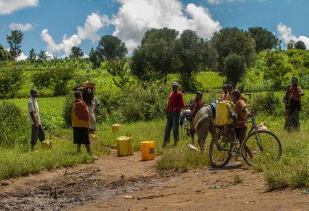 Residents collect water from a project supported by former Global Ambassador for World Vision, Meghan Markle, in Gatsibo district, Rwanda April 27, 2018. Picture taken April 27, 2018. REUTERS/Jean Bizimana