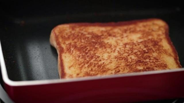 Frying bread with butter in a pan