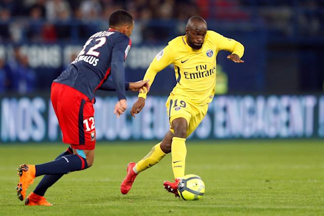 Soccer Football - Ligue 1 - Caen vs Paris St Germain - Stade Michel d'Ornano, Caen, France - May 19, 2018 Paris Saint-Germain's Lassana Diarra in action with Caen's Ronny Rodelin REUTERS/Pascal Rossignol