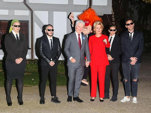 <p>Perry made her grand entrance as HRC wearing more clothing than we've ever seen her wear before! That's her beau, Orlando Bloom, in the back dressed as a troll-like Donald Trump. (Photo: Bauer-Griffin) </p>