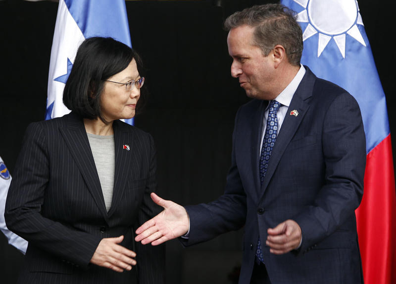 CORRECTS SPELLING OF GUATEMALA - Taiwan's President Tsai Ing-wen, left, shakes hands with First Vice President of Honduras Ricardo Alvarez after arriving at Soto Cano Air Base outside Comayagua, Honduras, Sunday, Jan. 8, 2017. The Taiwanese leader will meet with Honduran President Juan Orlando Hernandez on Monday, as part of a weeklong state tour to reinforce Taiwanese relations with Honduras, Guatemala, El Salvador, and Nicaragua. (AP Photo/Fernando Antonio)