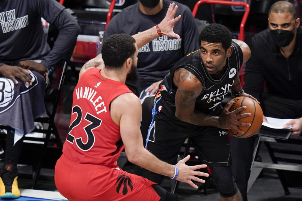 Toronto Raptors' Fred VanVleet (23) defends against Brooklyn Nets' Kyrie Irving during the first half of an NBA basketball game Friday, Feb. 5, 2021, in New York. (AP Photo/Frank Franklin II)