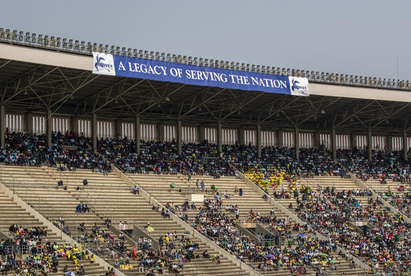 Members of the public sit in the stands during the state funeral for former president Robert Mugabe at the National Sports Stadium in the capital Harare, Zimbabwe Saturday, Sept. 14, 2019. African heads of state and envoys gathered to attend a state funeral for Zimbabwe's founding president, Robert Mugabe, whose burial has been delayed for at least a month until a special mausoleum can be built for his remains. (AP Photo/Ben Curtis)
