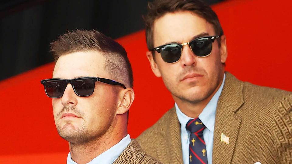 Brooks Koepka (pictured right) and Bryson DeChambeau (pictured left) attend the Ryder Cup opening ceremony.