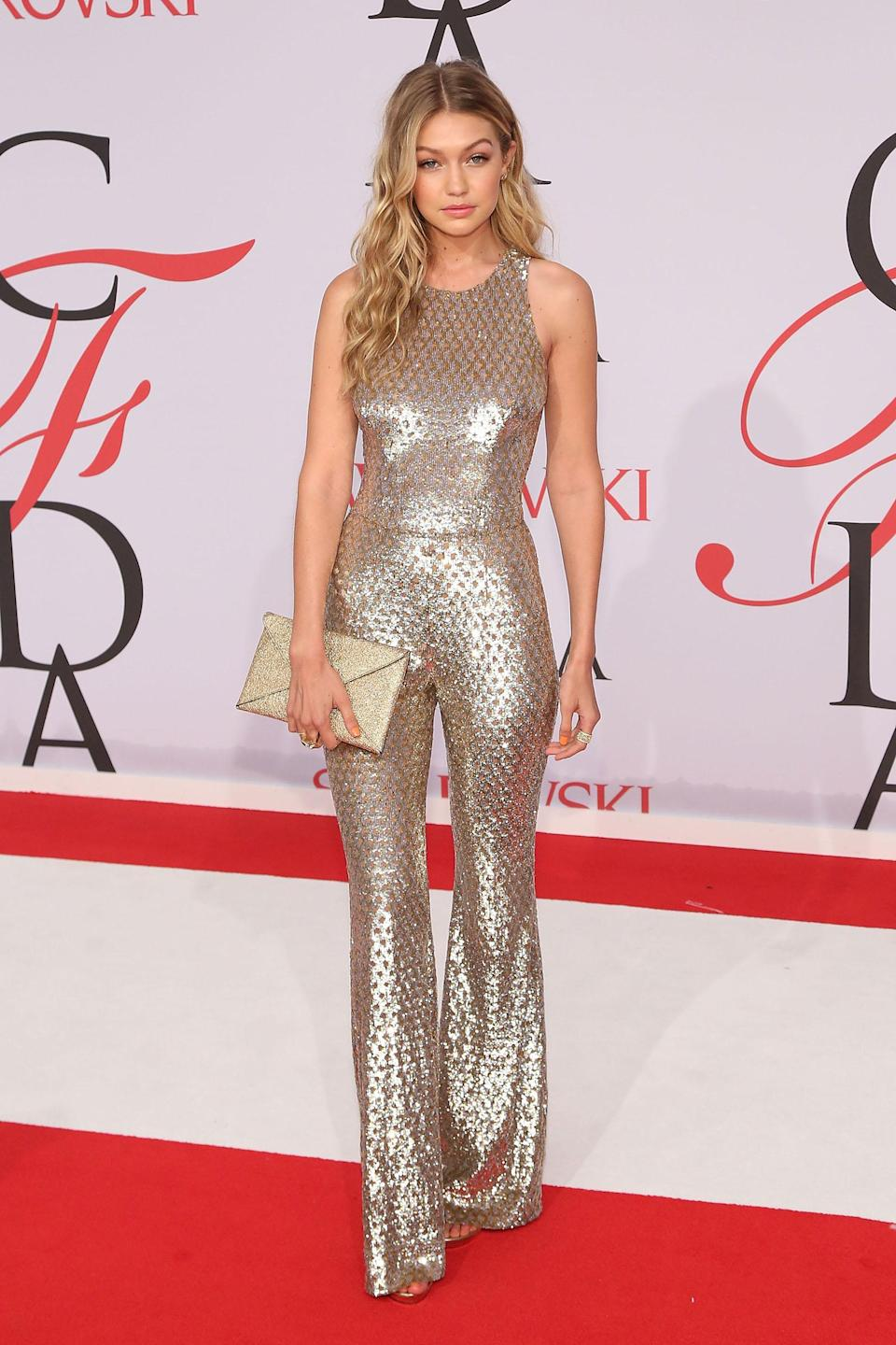<p>The supermodel paid homage to the origins of the jumpsuit, wearing this '70s-inspired Michael Kors look at the 2015 CFDA Awards. (Photo: Taylor Hill/FilmMagic) </p>