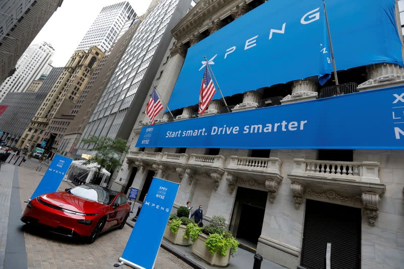 FILE PHOTO: An XPeng Inc. P7 performance electric car outside the New York Stock Exchange (NYSE) ahead of the Chinese company's IPO in New York