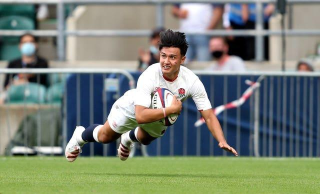 England's Marcus Smith dives in to score