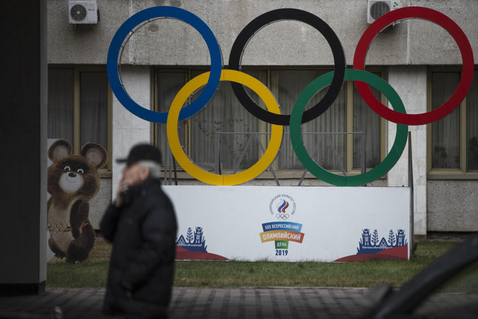FILE - In this Nov. 28, 2019 file photo Olympic Rings and a model of Misha the Bear Cub, the mascot of the Moscow 1980 Olympic Games, left, are seen in the yard of Russian Olympic Committee building in Moscow, Russia. Russia was banned Thursday Dec. 17, 2020 from using its name, flag and anthem at the next two Olympics or at any world championships for the next two years. The Court of Arbitration for Sport's ruling also blocked Russia from bidding to host major sporting events for two years. (AP Photo/Pavel Golovkin, file)
