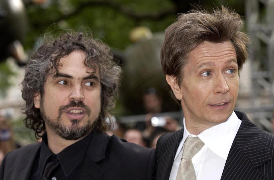 Director Alfonso Cuaron (left) and actor Gary Oldman arrive for the UK premiere of Harry Potter And The Prisoner of Azkaban at the Odeon Leicester Square in Central London, the third film from author JK Rowling's series of books on the boy wizard.   (Photo by Yui Mok - PA Images/PA Images via Getty Images)