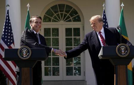 FILE PHOTO: Brazil's President Jair Bolsonaro shakes hands with U.S. President Donald Trump at the conclusion of a joint news conference in the Rose Garden of the White House in Washington, U.S., March 19, 2019. REUTERS/Kevin Lamarque/File Photo