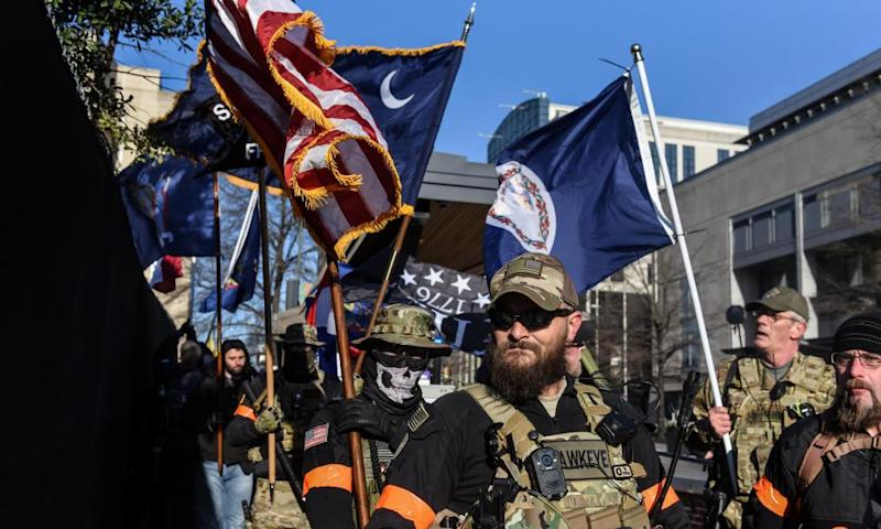 An armed militia gathers in front of the Virginia state capitol building in Richmond, Virginia, on 20 January.