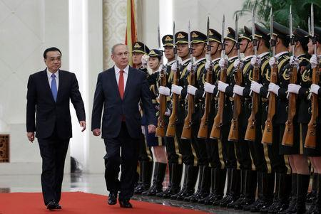 Israeli Prime Minister Benjamin Netanyahu and China's Premier Li Keqiang inspect honour guards during a welcoming ceremony at the Great Hall of the People in Beijing, China March 20, 2017. REUTERS/Jason Lee