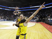 <p>UMBC's K.J. Maura (11) and Jourdan Grant celebrate the team's 74-54 win over Virginia in a first-round game in the NCAA men's college basketball tournament in Charlotte, N.C., Friday, March 16, 2018. (AP Photo/Gerry Broome) </p>