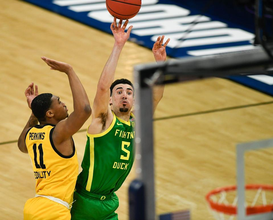 Oregon Ducks guard Chris Duarte (5) attempts to shoot the ball as he is fouled by Iowa Hawkeyes guard Tony Perkins (11) during the second round of the 2021 NCAA Tournament on Monday, March 22, 2021, at Bankers Life Fieldhouse in Indianapolis, Ind. Mandatory Credit: Sam Owens/IndyStar via USA TODAY Sports ORIG FILE ID:  20210322_jla_usa_2433.jpg