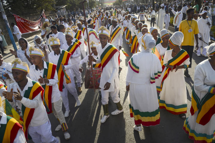 Christians from the Ethiopian Orthodox church celebrate the first day of the festival of Timkat, or Epiphany, in the capital Addis Ababa, Ethiopia Sunday, Jan. 19, 2020. The annual festival celebrates the baptism of Jesus Christ in the River Jordan. (AP Photo)
