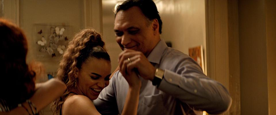 """Jimmy Smits dances with his screen daughter Leslie Grace during a living room party for """"In the Heights."""""""