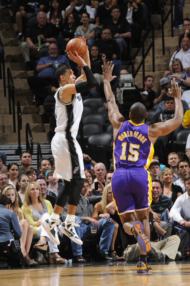 Danny Green #4 of the San Antonio Spurs shoots against Metta World Peace #15 of the Los Angeles Lakers on April 20, 2012 at the AT&T Center in San Antonio, Texas. (D. Clarke Evans/NBAE via Getty Images)