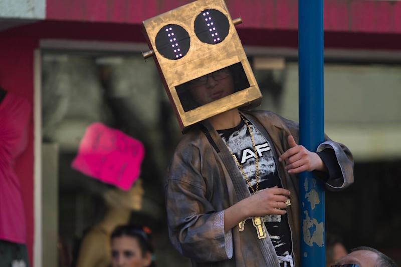 An Israeli boy in costume watches a Purim parade in Holon, Israel, Thursday, March 8, 2012. (AP Photo/Dan Balilty)